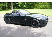 bmw z4 convertible 2.5i black fully loaded top spec with satnav.very nice car