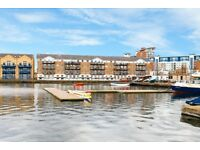 DIRECT WATER VIEWS FROM THIS FANTASTIC TWO BED TWO BATH APARTMENT WITH SECURE PARKING