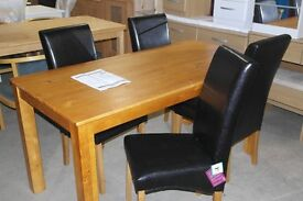 Brand new solid wood dining table and 4 skirted leather chairs!!!!!