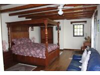4 poster bed in oak stained teak,Double...... 2 Wardrobes and 2 bedside cabinets.