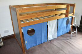 Childs Midsleeper Bed by Thuka with curtains underneath