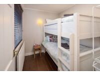 As new white bunk or two singles bed frame