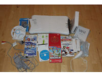 Nintendo Wii Console + WII fit board + 8 Games