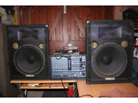 Yamaha EMX66m Powered mixer and Yamaha S15e speakers.