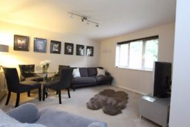 2 BED 1ST FLR FLAT SHORT WALK TO VILLAGE,REFITTED KIT,BATH WITH SHOWER,ENTRY PHONE,D/GLAZED,PARKING