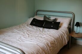 Double bed with matching bedside table