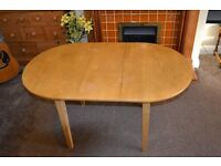 Small extendable dining table, with centre leaf folding insertion. Full size – 53``x 32``.