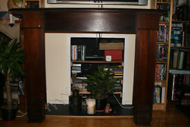 Dark Solid Wood Fireplace Surround