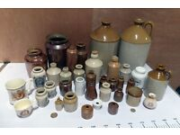 A selection of old and antique stoneware jars, inkwells and bottles in good condition.