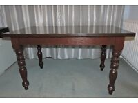 Mahogany Dinning table In good condition.