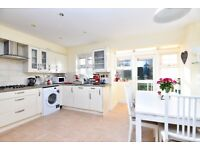 Beautiful four bedroom house in the Osier Crescent development with parking and private garden