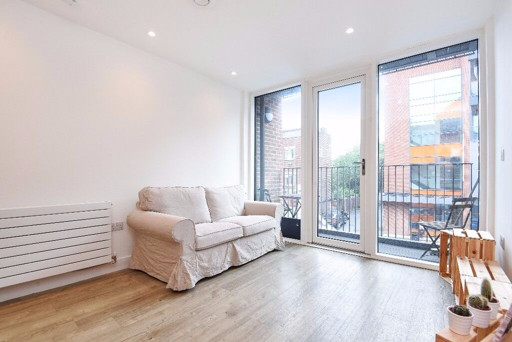 A modern two double bedroom apartment with a private balcony, situated on Tooting High Street.