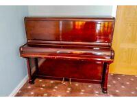 Bradon London upright piano in good condition