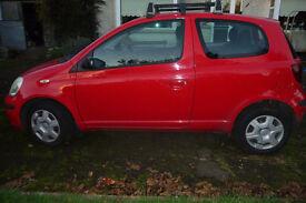 Toyota Yaris, with Toyota roof bars and bike rack