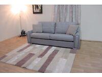 Ex-display Sisi Italia Victor grey leather and fabric 3 seater sofa