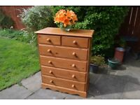 Solid pine chest of drawers with dovetail joints.
