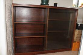 Large walnut veneer bookcase with sliding glass doors