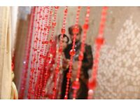 asian wedding female photographer/videographer and male photographer/videographer