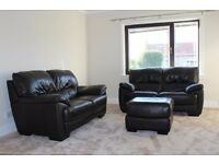 Pair of two seater dark brown leather sofas and stool