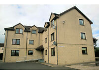 Spacious unfurnished Ground Floor 2 Bedroom Flat in quiet village location with off-street Parking