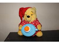 Winnie the pooh interacive toy with candle