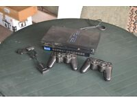PS2 with two wireless controllers