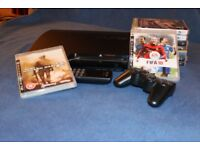REDUCED PRICE - PS3 console with game controller and 9 games