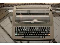 SHARP PORTABLE ELECTRONIC TYPEWRITER MODEL QL-210