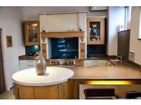 Complete kitchen by Callerton with Art Deco style mantle, Drum end unit and Corian worktops
