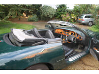 Jaguar XK8 Convertible : British Racing Green with powered Black Hood