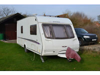 2005 Swift Challenger 550 four berth fixed end bed with awning, two gas bottles, hitch security lock