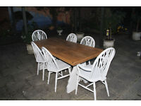A beautiful shabby chic 185 cm oak table and six chairs