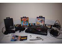 Sega Mega Drive game console, 3 games and console accessories - £38.00