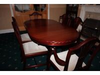 Dinning room table and six chairs.