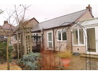 FOUR BEDROOM BUNGALOW WITH OFF STREET PARKING!