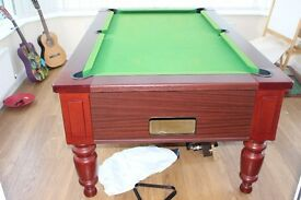 7ft x 4ft slate bed pool table. All accesories including lights, cues and 2 sets of balls