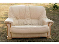 FOR SALE OAK AND CREAM LEATHER TWO SEATER .