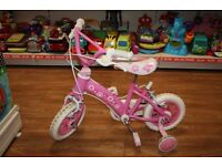 Pink first bike with stabilisers