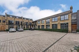 A LUXURY ONE BEDROOM WAREHOUSE CONVERSION SET IN A GATED DEVELOPMENT MINUTES FROM CAMDEN TOWN