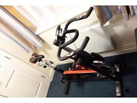 JLL IC300 Indoor Cycling exercise spin bike with seat cushion