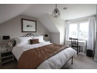Sunny attic room with stunning views of Bath for rent. Wifi, garden, free parking, 15 min to town