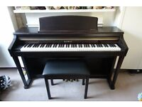 For sale a Kawai Digital Piano CA63 (Rosewood) with stool, in excellent condition - collection only