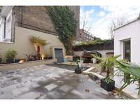 Cathcart Road SW10. Exceptionally spacious three double bedroom garden flat.