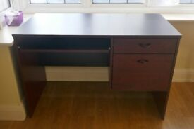 Small dark wood finish office desk with 2 drawers and keyboard drawer