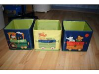 Collapsible cube storage boxes with train motifs
