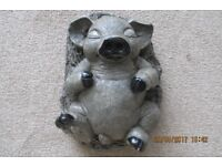 Collectible ornamental sleeping pig, lying on its back.