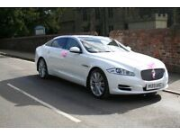 STUNNING WHITE JAGUAR WEDDING CAR