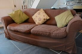 Chocolate matching sofa and armchair with spare covers. Must go!