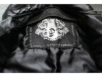 Leather look Childrens jacket in black