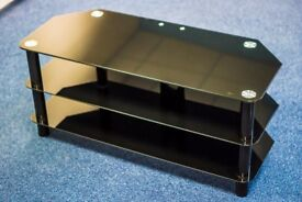 Glass Corner TV Stand. Excellent condition. Can deliver.